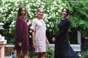 Three girls posing on camera