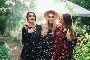 Three girls are photographed on came