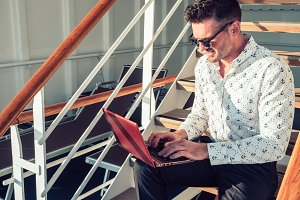 Stylish, attractive man with laptop