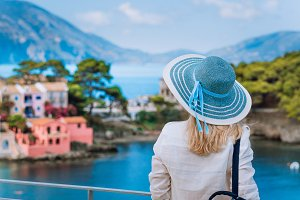 Tourist woman in blue sunhat on view