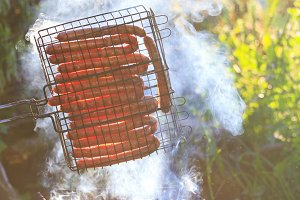 Barbecue in nature, fried sausages