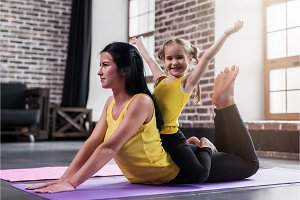 Young Caucasian mother doing yoga