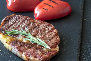 Grilled beef steak with bell peppers