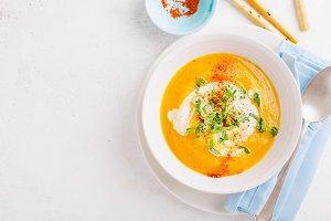 Pumpkin creamy soup in bowl