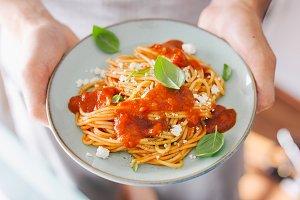 Man eating classic italian pasta