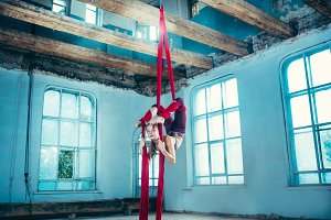 Graceful gymnast performing aerial