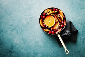Mulled wine with fruits in saucepan