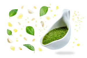 Pesto sauce with flying ingredients