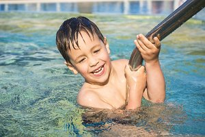 Child learn to swim in the pool.