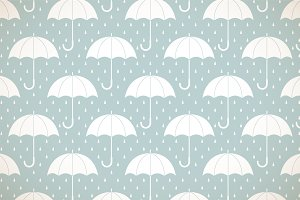 White umbrellas on blue pattern