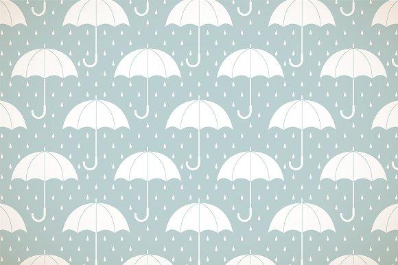 White umbrellas on blue pattern