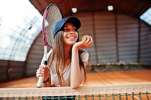 Young sporty girl player with tennis