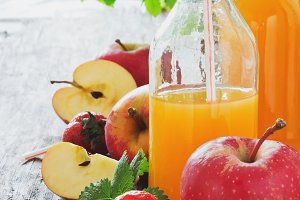 fruit juice, ripe apples and strawbe