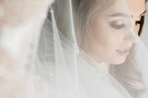 Portrait of charming bride enveloped