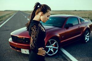 Beauty woman near red car mustang