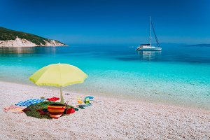 Umbrella and beach accessories on