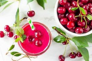 Cherry milkshake or smoothie on a wh