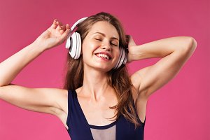 Beautiful woman wearing headphones