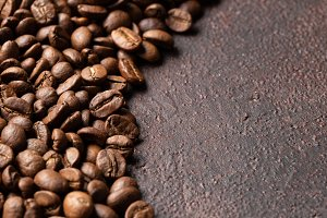 Close-up roasted coffee beans backgr