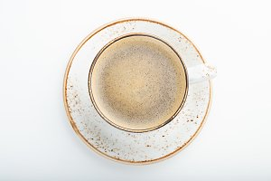 White Cup with cappuccino coffee on