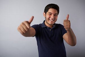 Smiling hispanic man with thumbs up