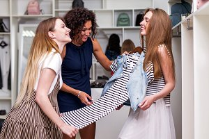 Young girlfriends choosing new