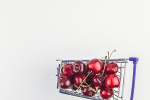 Ripe cherries in a shopping cart iso