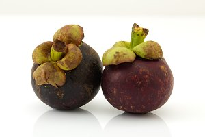 The purple mangosteen on white