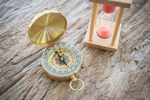 Antique golden compass on wood