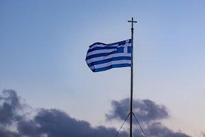 Greek flag at sunset. Paros, Greece