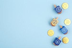 Blue backdrop with dreidels & coins