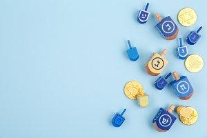 Multicolour dreidels & coins on blue