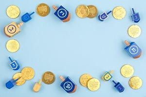 Frame of multicolor dreidels & coins