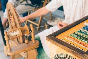 Woman spinner works wool