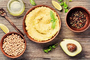 Hummus on rustic wooden table