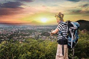 Man hiking at sunset mountains