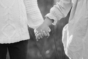 Girls holding hands. Black and White