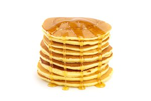 Pancakes stack with honey isolated