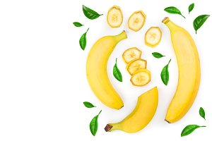 whole and sliced bananas with green