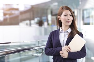 Business woman holding tablet in cit