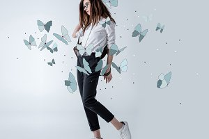 Stylish hipster woman with butterfli