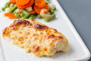 Baked cod fish fillet under cheese,