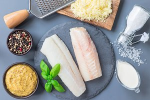 Fresh raw cod fillet with ingredient