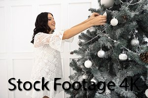 Teen girl and Christmas tree