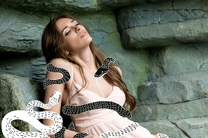 young seductive woman with snakes