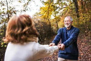 Senior couple in an autumn nature