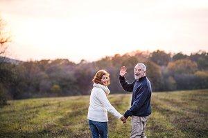Senior couple walking in an autumn