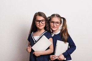 Two small schoolgirls with glasses