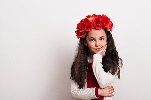 A small girl with flower headband