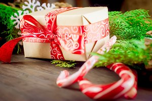 Gift box tied with a red ribbon , fi